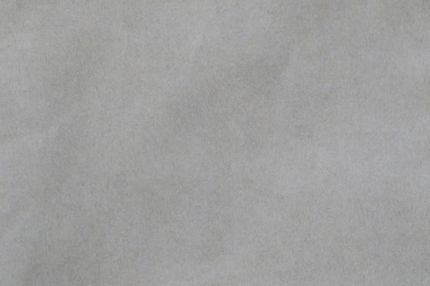 Gładka szara tekstura papieru artystycznego.