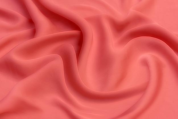 Gładki elegancki różowy kolor jedwabiu lub satyny luksusowej tkaniny tekstury, abstrakcyjny wzór tła.