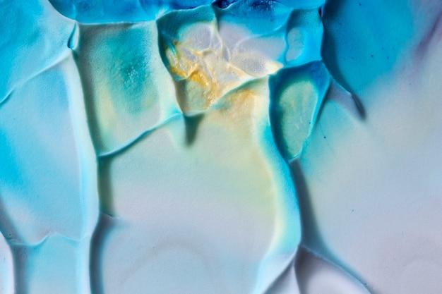 Gładki tekstury tło z błękitnym i żółtym akwarela projektem