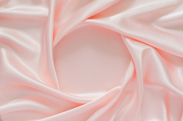 Gładkie eleganckie faliste różowe satynowe tkaniny tekstury tła z miejscem na tekst