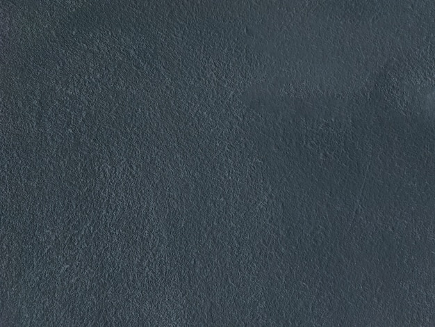 Głębokie niebieskie szorstkie betonowe tło