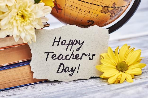 Globus i bukiet kwiatów. dziękuję nauczycielu.