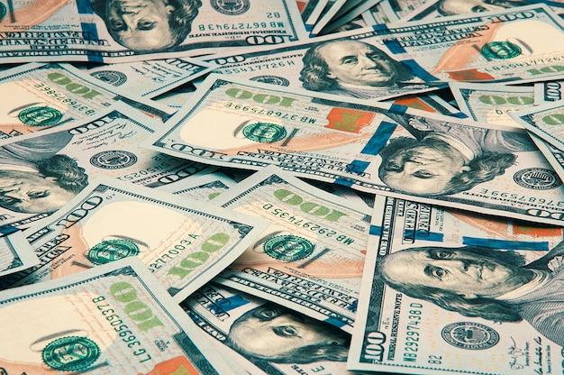 Gotówka sto dolarów rachunki dolar obraz tła rozproszone dolary
