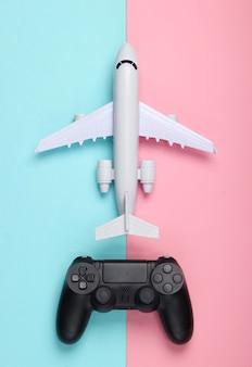 Gra powietrzna. gamepad, samolot na niebiesko-różowym pastelu