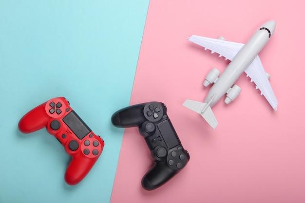Gra powietrzna. gamepady, samolot na niebiesko-różowym pastelu