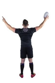 Gracz rugby świętuje z piłką