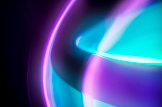Gradientowe tło z różowym i niebieskim efektem świetlnym