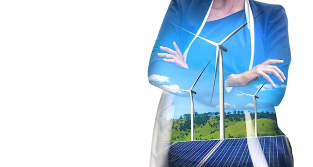 Grafika z podwójną ekspozycją ludzi biznesu pracujących nad farmą wiatrową