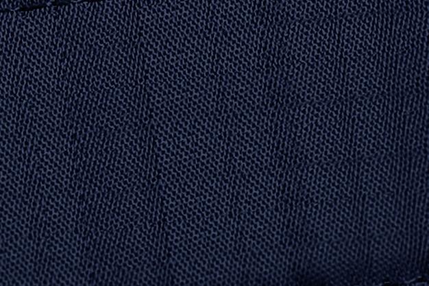 Granatowe dżinsowe tło w fakturze tkaniny