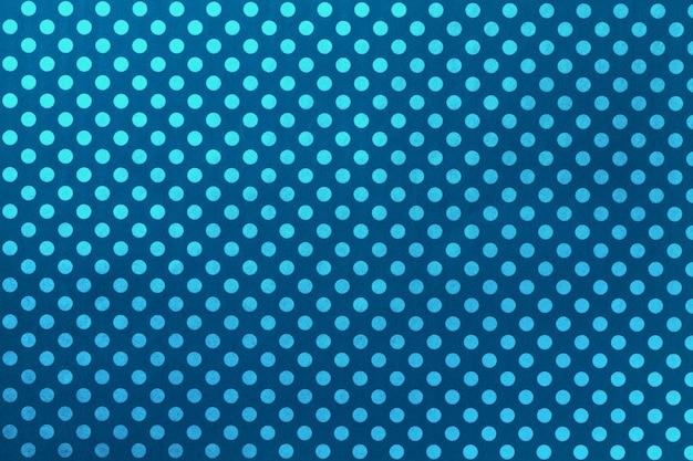 Granatowe tło z papieru do pakowania z wzorem turkusowej kropki zbliżenie.