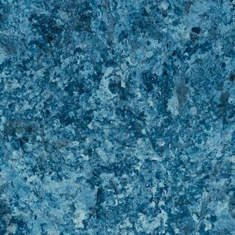 Granitowa tekstura, niebieska granitowa powierzchnia na powierzchnię, materiał na dekoracyjną teksturę, wystrój wnętrz.