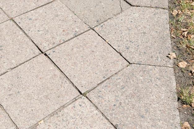 Granitowe płytki drogowe tło