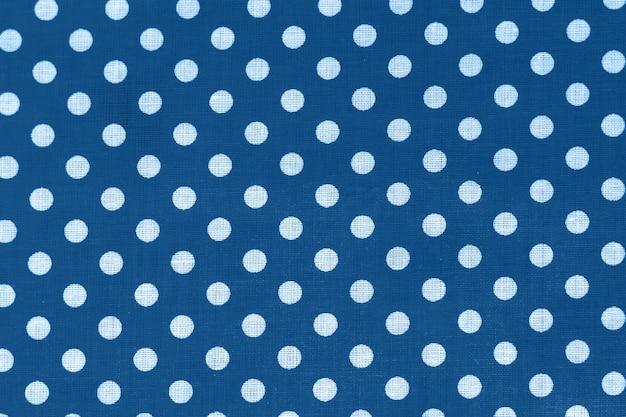 Groszki na niebieskim płótnie tekstury bawełny