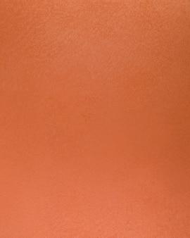 Gruba pomarańczowa powierzchnia ściany betonowej