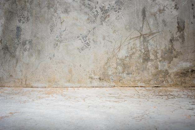 Grunge betonowy pracowniany izbowy tło z światłem