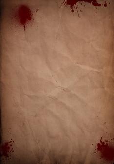 Grunge krew splattered papierowym tle