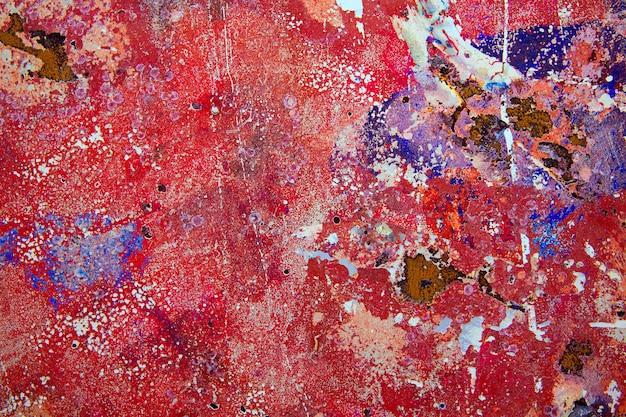 Grunge tło w czerwieni i ośniedziały colourful