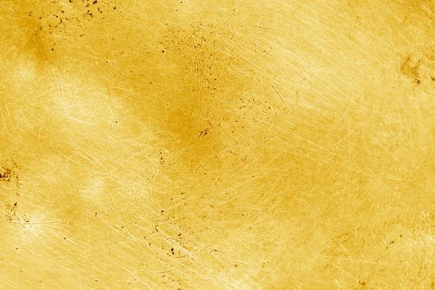 Grunge złota tło lub tekstura