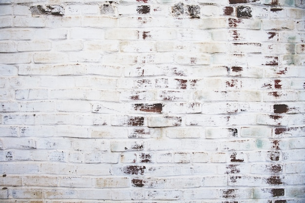 Grungy wyblakły mur z cegły