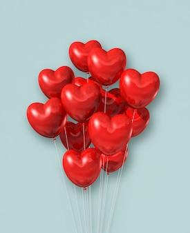 Grupa balony powietrza w kształcie czerwonego serca na jasnoniebieskim