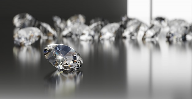Grupa diamentów umieszczona na błyszczącym