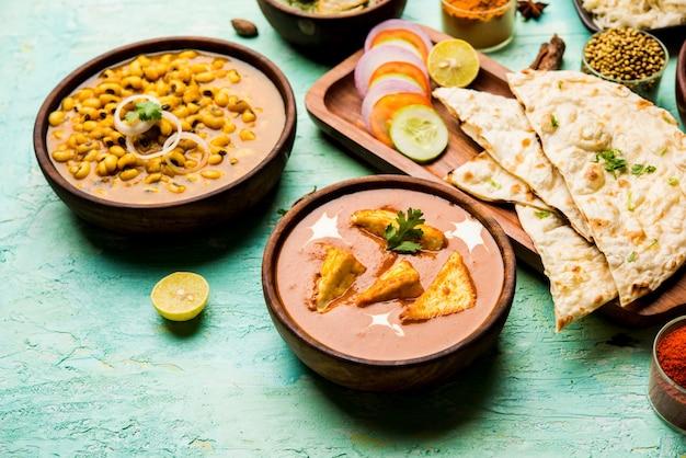 Grupa indyjskich potraw, takich jak masło palak paneer masala, choley lub chola i curry black eyed kidney beans z naan i ryżem