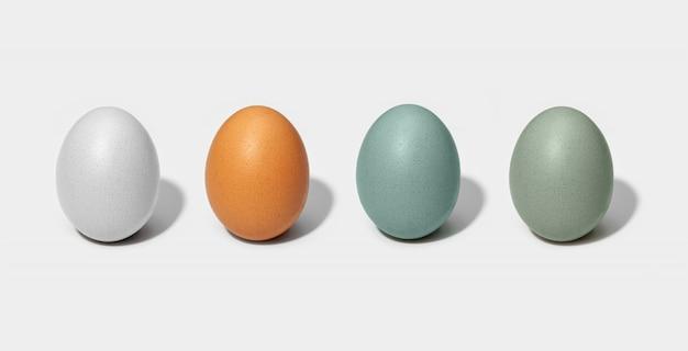 Grupa kurczaków jajka odizolowywający na białym tle. jajko białe, brązowe, zielone i niebieskie