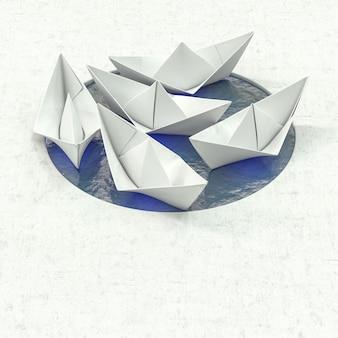 Grupa łodzi origami papieru w małym basenie z wodą
