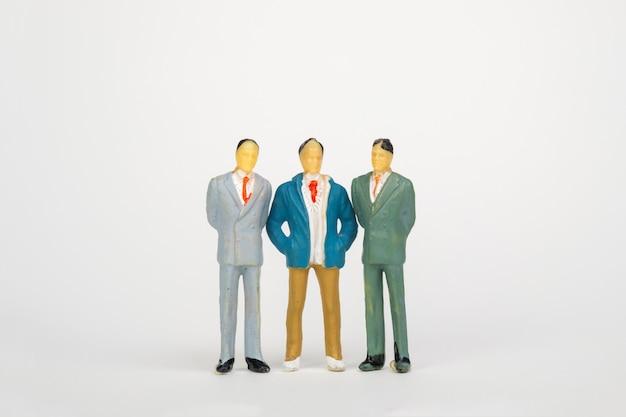 Grupa postaci miniaturowy biznesmen
