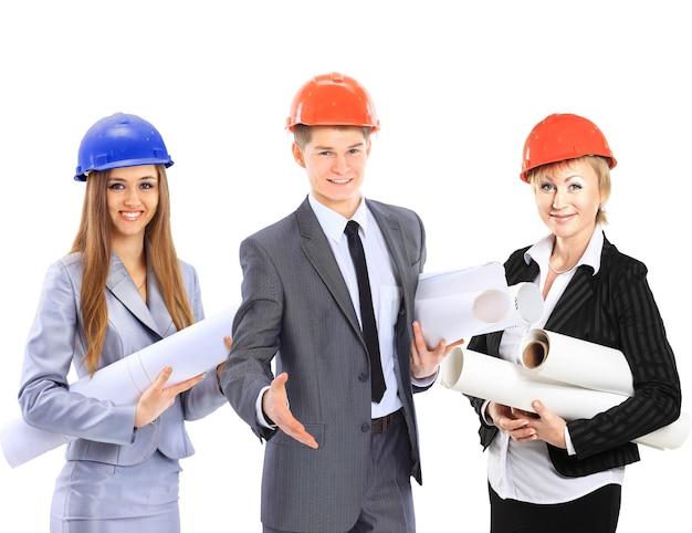 Grupa pracowników budowlanych. pojedynczo na białym tle.