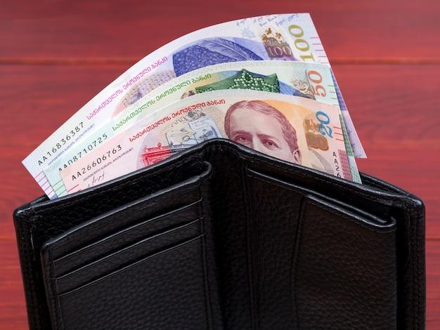 Gruzińskie lari w czarnym portfelu