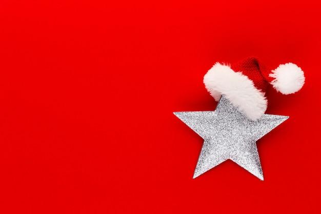 Gwiazda betlejemska, wystrój na pastelowym kolorowym tle