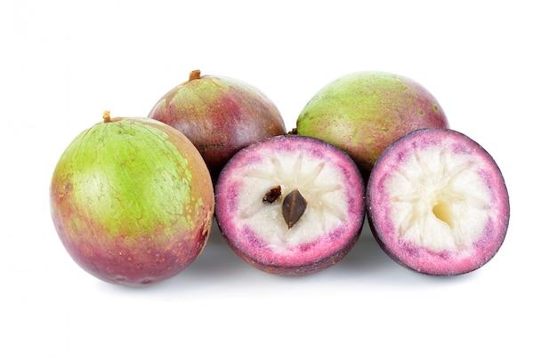 Gwiazdowy apple, chrysophyllum cainito, północna tajlandzka owoc, odizolowywająca.