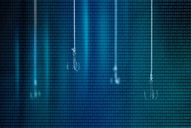 Haczyki wędkarskie wiszą na tle zrobionym z kodów binarnych. pojedynczy hak w zbliżeniu ostrości. ruch z wykorzystaniem techniki komputerowej. cyberprzestępczość