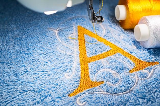 Hafciarka i logo na ręczniku