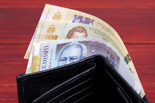 Haitańskie pieniądze w czarnym portfelu