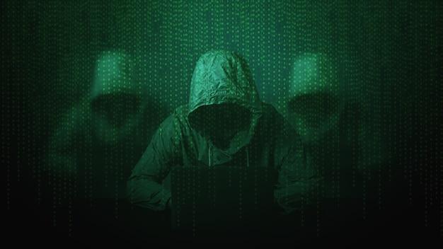 Haker na ekranie z kodem binarnym. koncepcja bezpieczeństwa cybernetycznego.