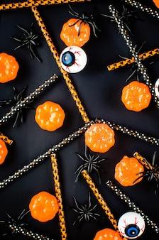 Halloween tło z wzorem cukierków