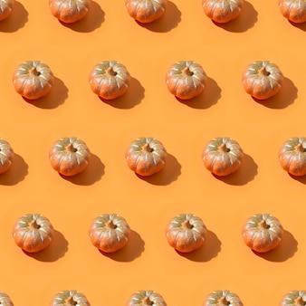 Halloweenowy bezszwowy wzór dynia dla tapety lub paczka papieru.