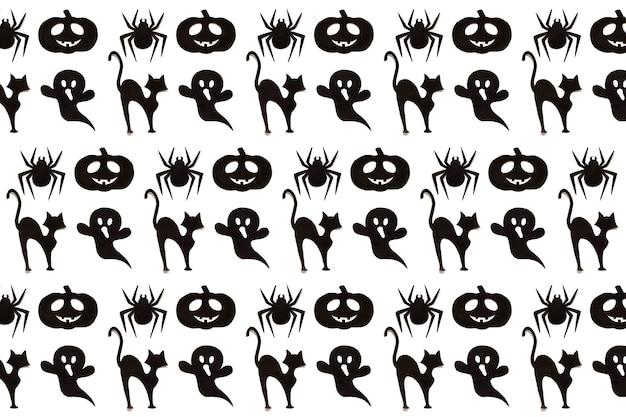 Halloweenowy wzór. kolekcja kreskówka czarno na białym tle. sztuka papieru. koncepcja szczęśliwy wakacje halloween.