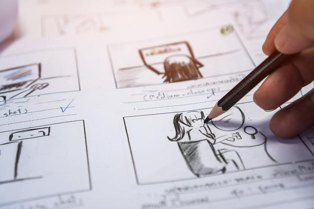 Hands on storyboard movie layout do przedprodukcji, kreatywne rysowanie narracji na potrzeby filmów medialnych do produkcji procesowej. scenariusz edytorów wideo i pisanie grafiki w formie wyświetlanej w trybie tworzenia zdjęć