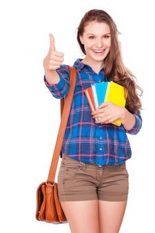 Happy m? odych studentów dziewczyna trzyma ksi ?? ki, liceum lub college graduand, cute nastolatek dorywcza u? miecha si ?.