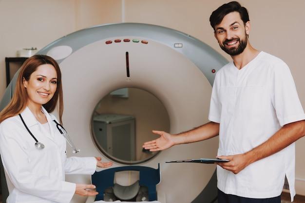 Happy radiology doctors invite to ct diagnostic.