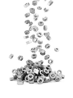 Heap of metal screw steel nuts falling