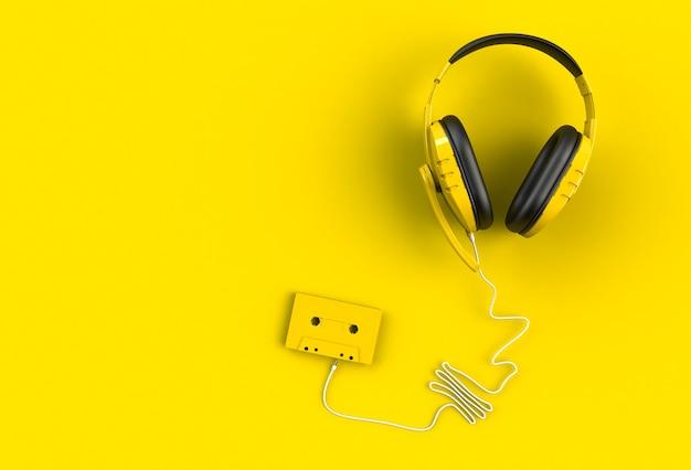 Hełmofony z kasety taśmą na żółtym tle