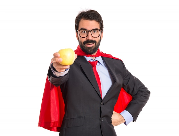 Hipster biznesmen ubrany jak superhero gospodarstwa jabłko