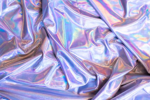 Holograficzny opalizujący syrenka folia tekstura tło. futurystyczne neonowe modne srebrne kolory