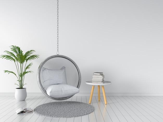 Huśtawka i poduszka w białym pokoju