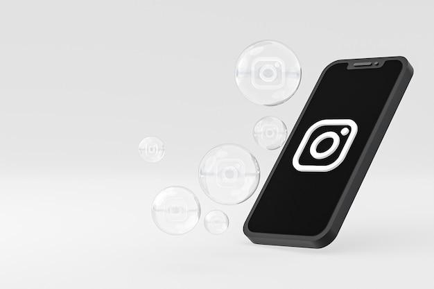 Ikona instagrama na ekranie smartfona lub reakcje mobilne i instagramowe uwielbiają renderowanie 3d na białym tle