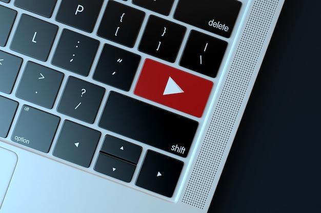 Ikona youtube na klawiaturze laptopa koncepcja technologii